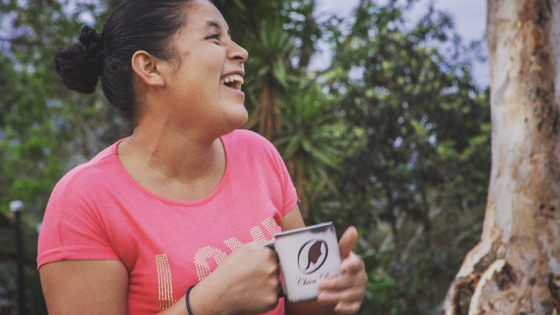 female coffee producer drinking her own roasted coffee